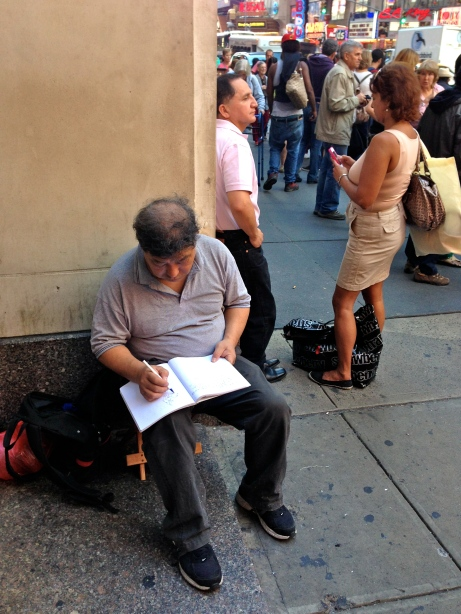 This guy was sketching in Times Square, without a care in the world. Let's all be more like this guy.