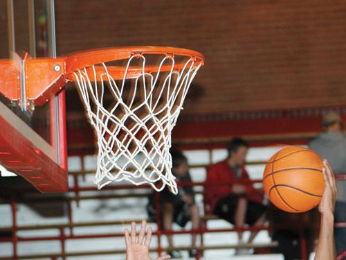 """A stock photo, because thankfully no photos exist of me """"playing basketball"""""""
